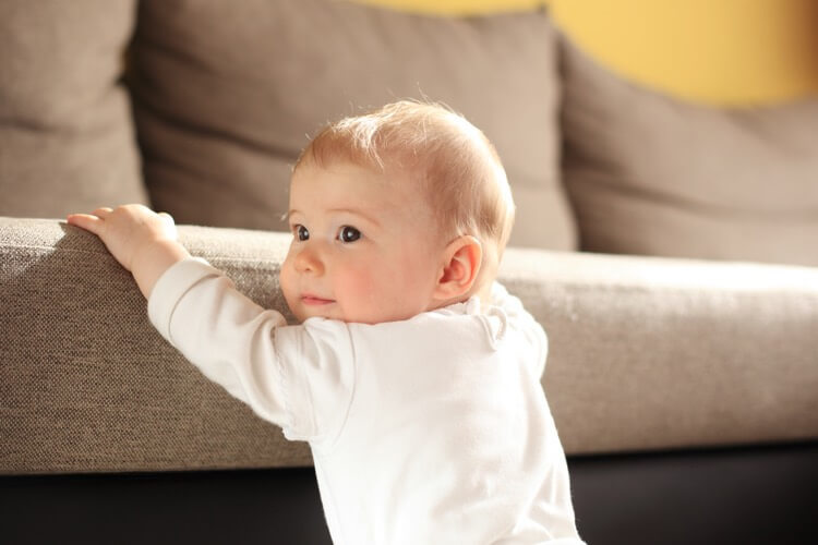 Cute baby at couch in room