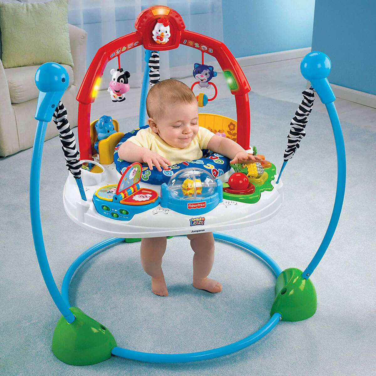 Baby is playing in Fisher-Price Laugh & Learn Jumperoo in living room