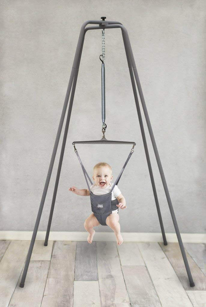 Image of a baby in Jolly Jumper with Super Stand on white background.