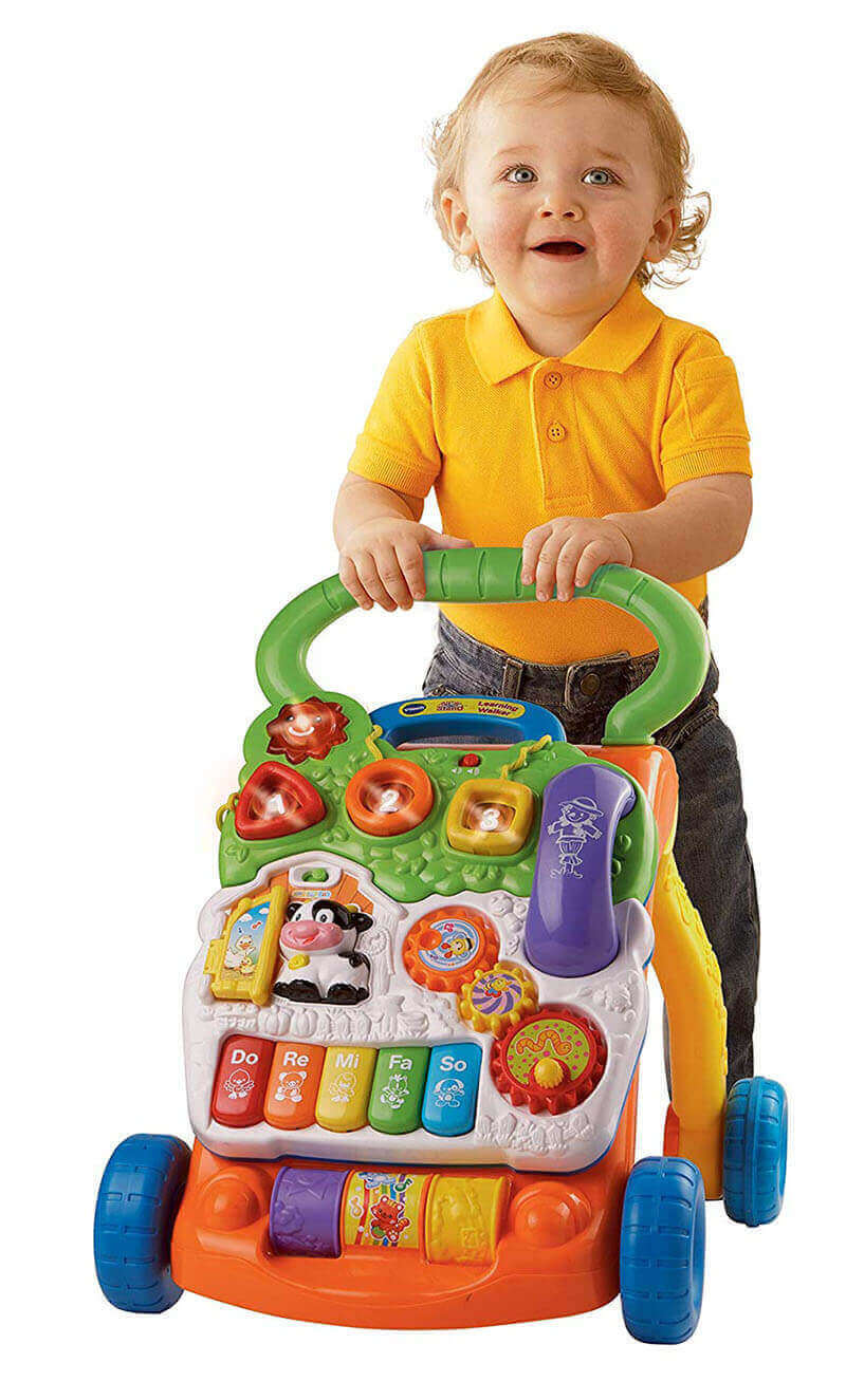 Baby is learning to walk with the help of Vtech Walker